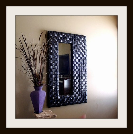 Off-centered Mirror - Recycled/Upcycled Bicycle Inner tube. $300.00, via Etsy.