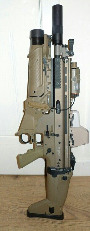 "SCAR's 40mm Enhanced Grenade Launcher  Module  (""EGLM""). Suppressor. Optical sight. The accessory at front looks like FN FCU fire control unit for the grenade launcher."