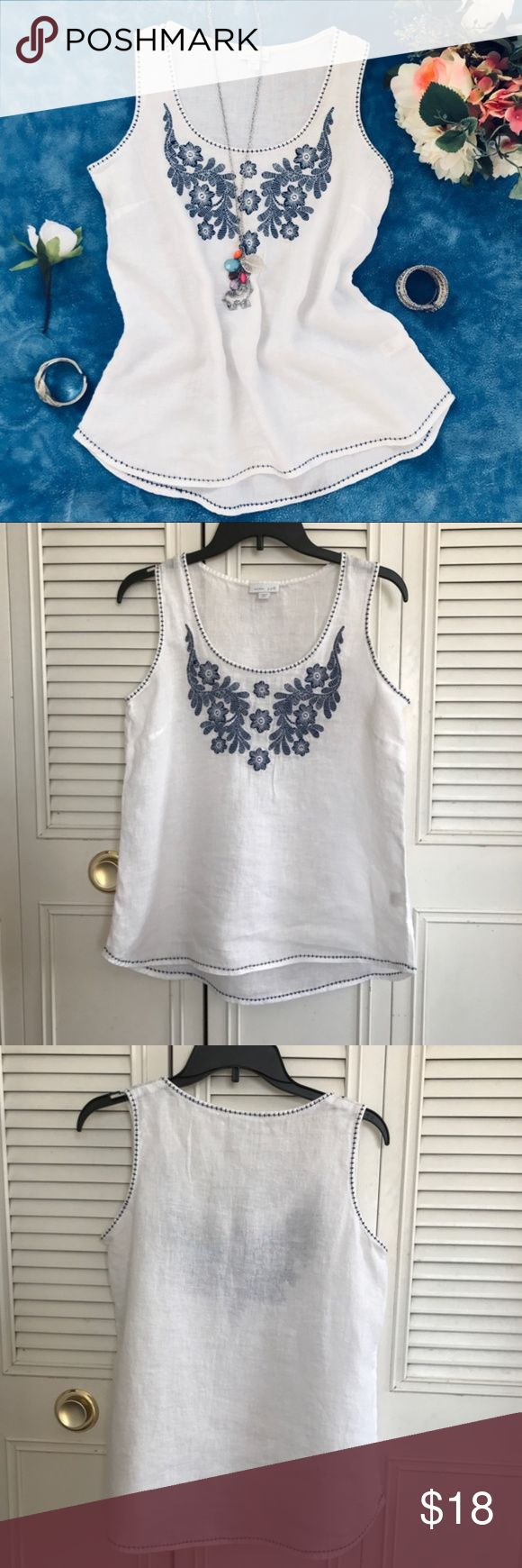 """J. Jill Women Sleeveless Embroider White Top This women's sleeveless top is come in a white color. It feature a beautiful embroider navy blue flowers around the front chest and navy blue line around the bottom, sleeve, and neckline. See picture. Good condition.  Material: 100% Linen exclusive of decoration.  Top to bottom: 24""""  Chest: 18.5""""  Measurement are base on item lay flat on the floor. J. Jill Tops Blouses"""