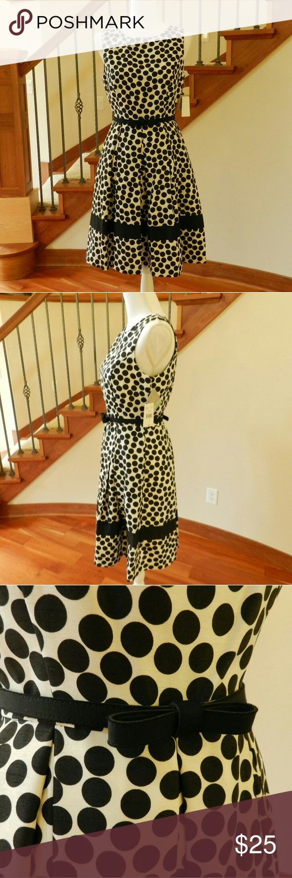 "Hepburn dot dress Audrey Hepburn style dress! ?Ivory polyester printed with black dots, and cinched with an adjustable belt. ?New with tags. ?Size 8. ?14.5""W 18""B 38""L Danny and Nicole Dresses Midi"