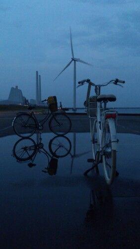 Green Tech, Green transport and modern power plant on a eveningride