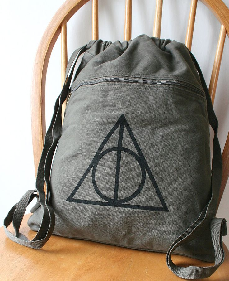 How much of a loser would I be if I got this for Bonnaroo? Deathly Hallows Canvas Backpack