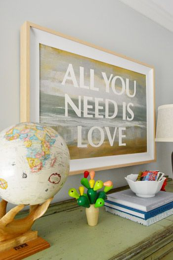 Create customized art by adding words to a painting with the help of this home decor hack.