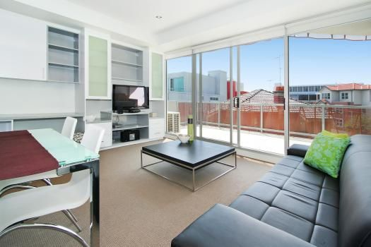 13/23 Irwell Street, St Kilda, Melbourne. This St Kilda apartment epitomises elegant apartment living right in the middle of this sought after Melbourne suburb.  This apartment comes with the maximum possible pay TV (Foxtel) package, ie, you have access to all possible channels.  A fully equipped open plan kitchen features new appliances and overlooks the dining and lounge areas. Gorgeously furnished, this area is the perfect place to relax and enjoy your homemade espresso coffee.