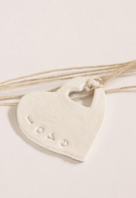 Make with paperclay for mother/daughter pendants.... still not sure of finish or if something should be written/stamped on the front.  JE