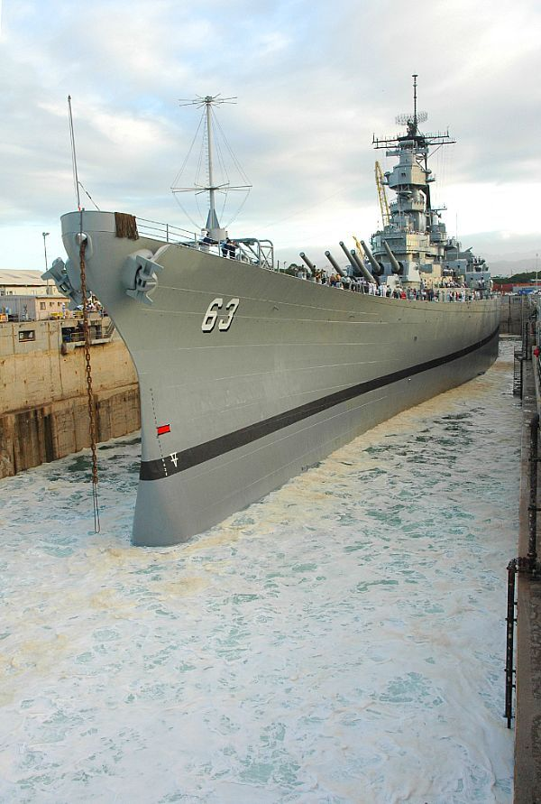 Seawater floods Dry Dock 4 at Pearl Harbor Naval Shipyard during the undocking of the battleship EX-USS Missouri (BB 63).