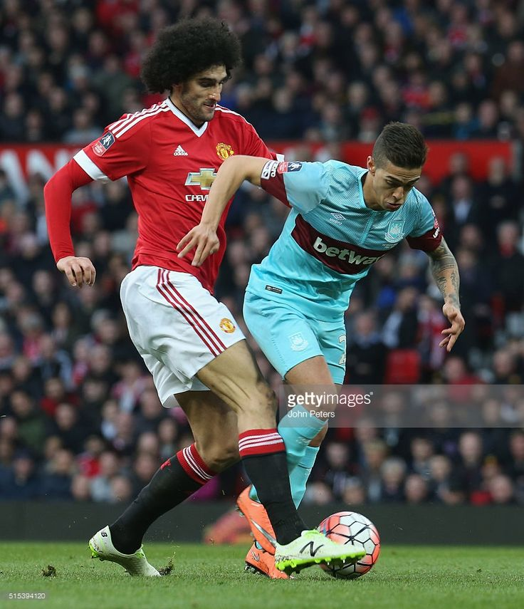 Marouane Fellaini of Manchester United in action with Manuel Lanzini of West Ham United during the Emirates FA Cup Sixth Round match between Manchester United and West Ham United at Old Trafford on March 13, 2016 in Manchester, England.