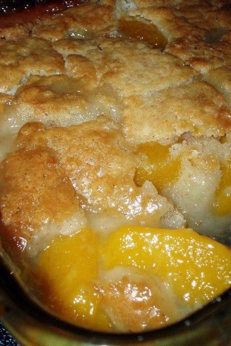 Peach cobbler  2 cups fresh sliced peaches (or 1 can of sliced peaches, drained) 1 cup Bisquick mix  1 cup milk 1/2 tsp nutmeg 1/2 tsp cinnamon 1/2 cup butter, melted 1 cup of sugar Preheat oven to 375. In an 8 x 8 baking dish, stir Bisquick mix, milk, nutmeg & cinnamon together until thoroughly mixed. Stir in melted butter until crust is fully moistened. In a medium mixing bowl, stir sugar & peaches. Spoon peaches over the cobbler crust. Bake for one hour.