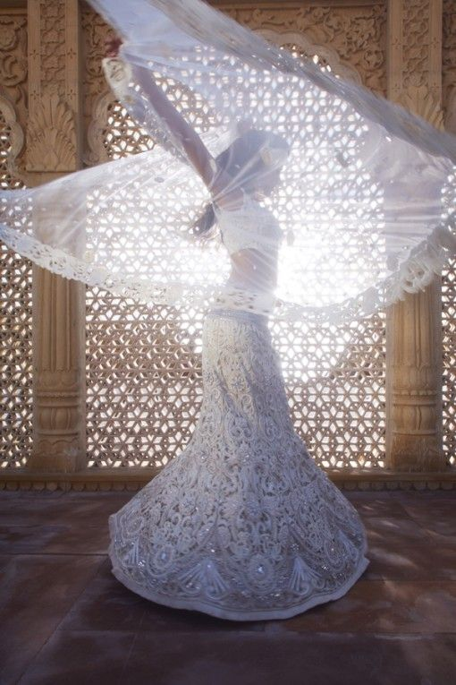 Gorgeous <3 I love Indian weddings! And photos with sheer shawls and light :) Off white cutwork lehenga by Kalki $1,445