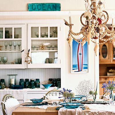 This shell-crusted chandelier brings the beach into the dining room.
