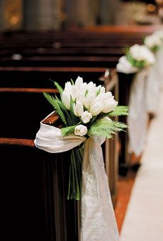 Bouquets of tulips and ferns adorned pews. Photo by Lisa Lefkowitz; Florals by Kathleen Deery Design #weddings