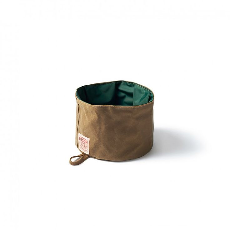 Our collapsible dog bowl folds to store in a pocket or clips onto your pack with the attached hanging loop.