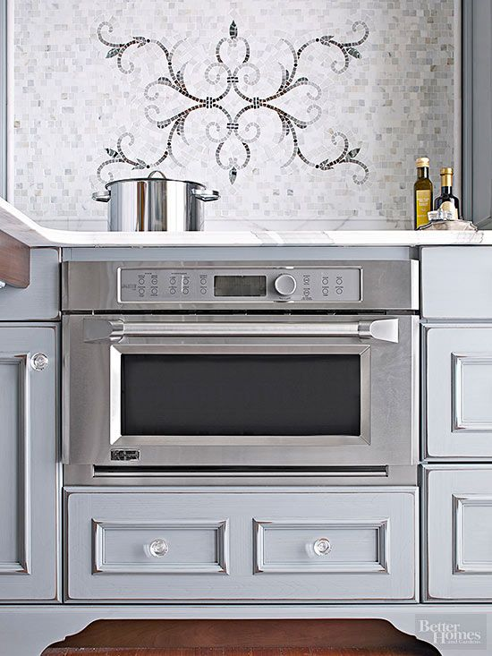 Downsized, drawer-size, and double-duty appliances are efficiency all-stars in tight kitchens. This induction cooktop's flat surface doubles as a countertop when not in use. The speed-cook oven also works as a microwave, warming drawer, and convection oven. Surrounding drawers provide relief storage.