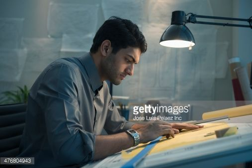 Stock Photo : Architect working at drafting table in office
