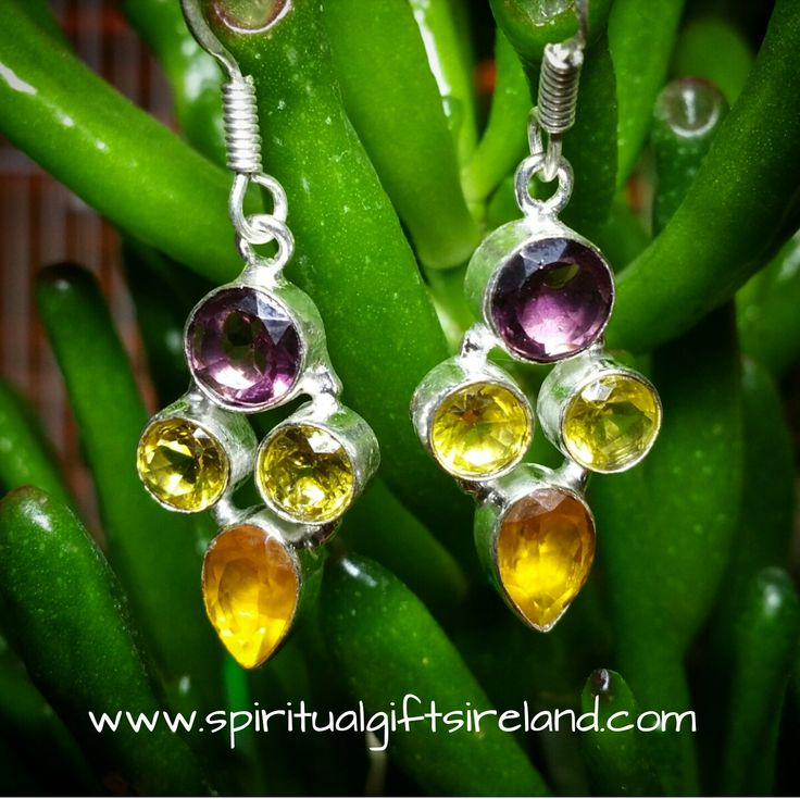 Tri-Stone Yellow Tourmaline, Citrine and Amethyst Handcrafted Earrings - Spiritual Gifts Ireland.   Yellow Tourmaline and Citrine are two very potent gems.  Bright and energetic they mirror the golden colour of the sun's rays.  Yellow is the most healing of all colours.  It resonates with the Solar Plexus which is where all our main organs lie.  It signifies optimism, well-being, blessings and hope that better days are here.  Yellow relates to our self-worth, how we feel about ourselves, our…