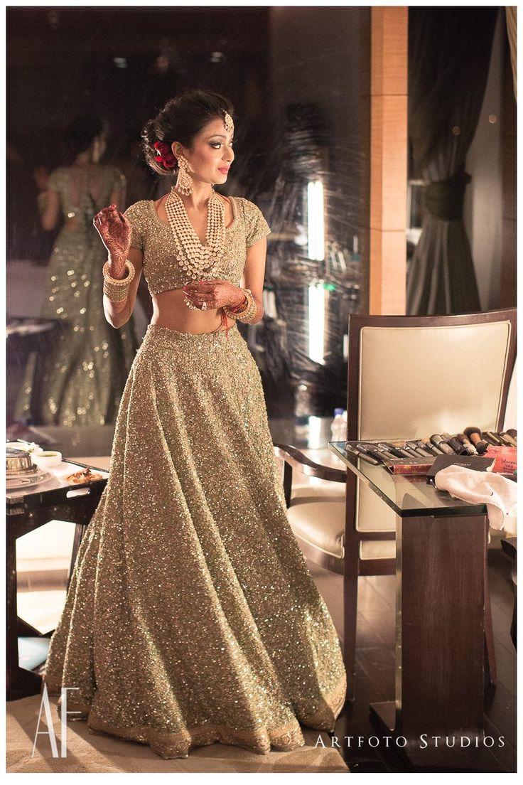 Bride In A Sabyasachi Matching Gold Sparkling #Lehenga & #Blouse.
