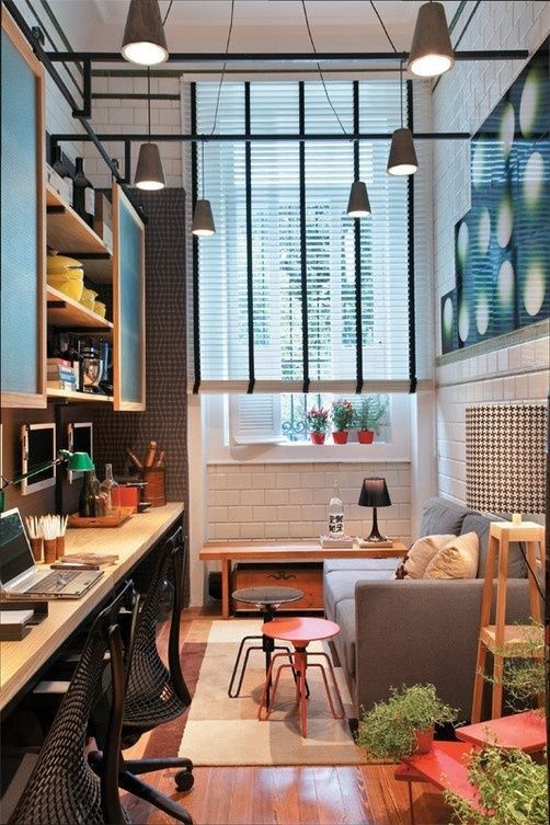 tall, narrow living room // hanging/sliding glass doors on upper cabinets // white subway tile walls