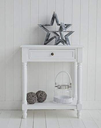 Grey and white decorative standing stars on the white Cove side table