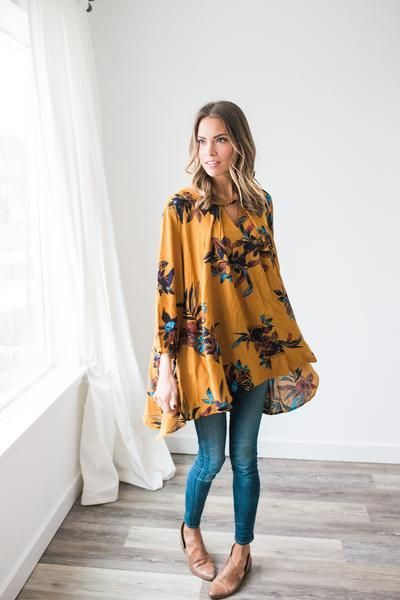 Flowy mustard top with front keyhole detail 100% Rayon Model is wearing a size small *We are unable to re-stock this top, you've been warned ;)