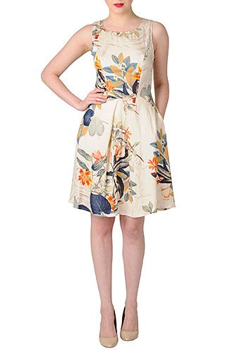 Love  the fabric, silhouette, pockets and little cut out on back.