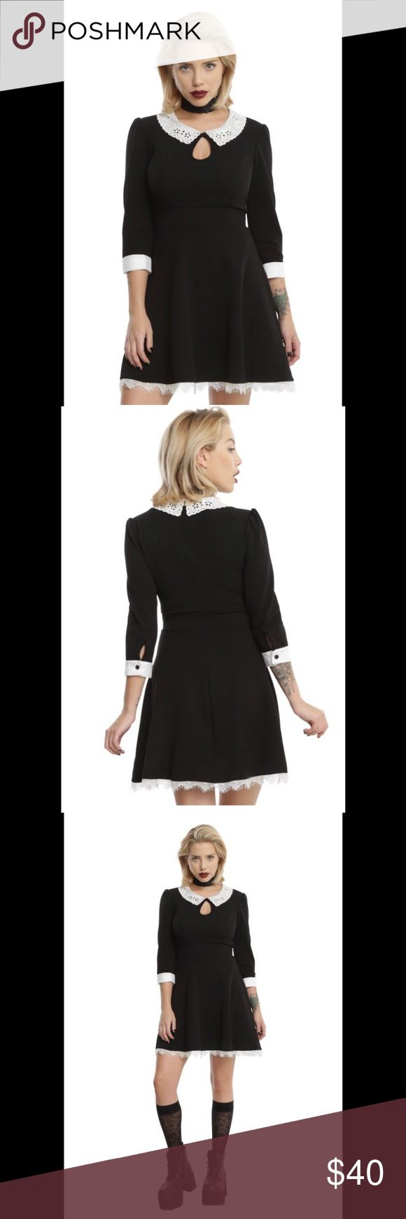 American Horror Story maid Hot Topic dress This dress is 96% polyester and 4% spandex. It hits about 3 inches above the knee. The material is pretty thick but has a lot of stretch and the dress comes in at the waist. Very figure flattering. The keyhole cutout is sexy but not too revealing. New with tags. Hot Topic Dresses