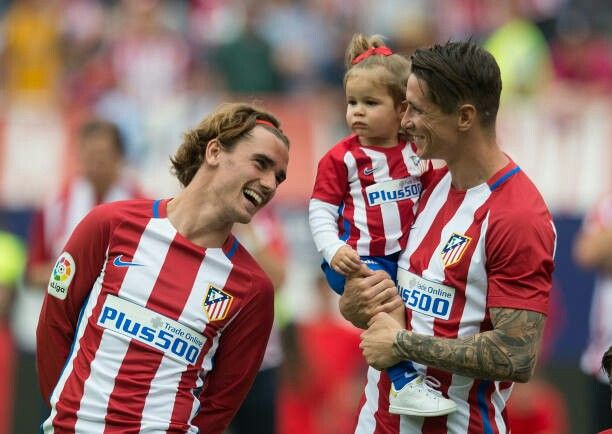 Fernando Torres with his daughter Elsa and his team mate Antoine Griezmann