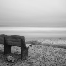 See more of my work at www.LarryMarshallPhotography.Com  This is a photo of the bench overlooking Seaside Reef in Cardiff By The Sea. I used a long exposure and stacked 10 stop and 6.6 stop ND filters to smooth out the clouds and waves.