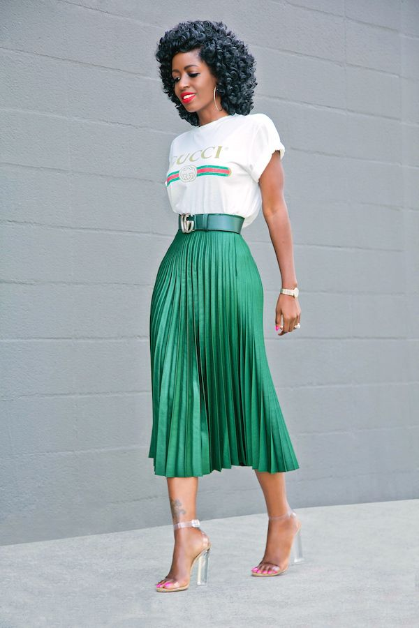Gucci Logo tee, emerald satin Pleated tea Skirt, silvery chunky-heeled sandals, cranberry smile