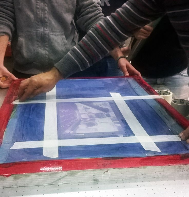 Before using the semi-automatic screen printing machine we carefully add duct tape on the silk screen so the pressure of the squeegee does not break it.