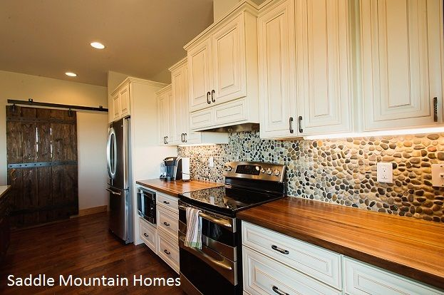 Pebble Tile Backsplash would look great with soapstone and it looks great with wood counters