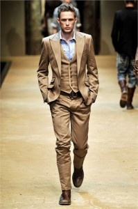 Camel 3 piece suit w/ a sky-blue point collar dress shirt.