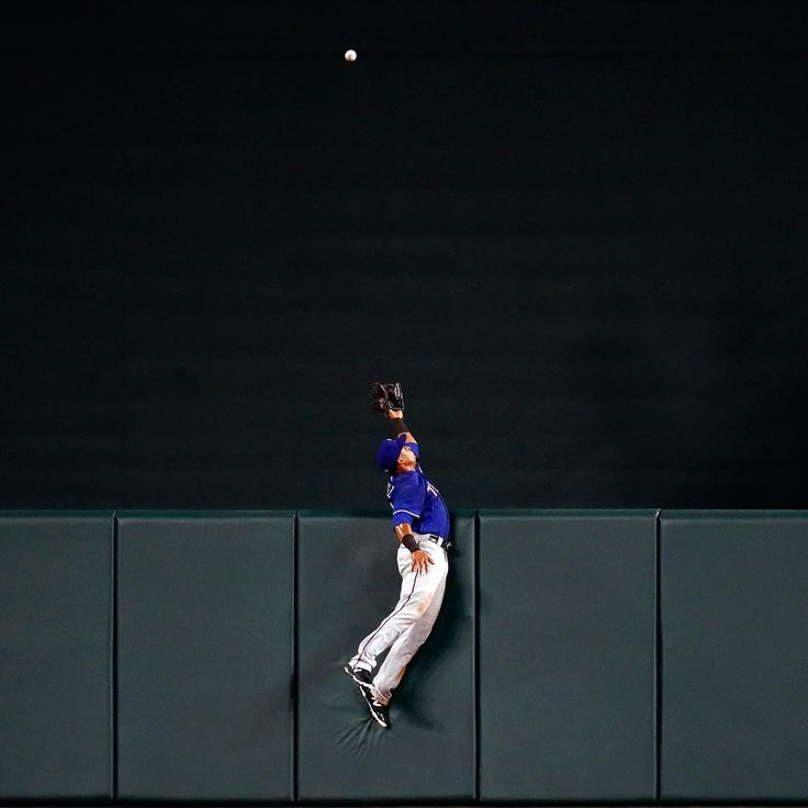 Carlos Gómez, center fielder on the Texas Rangers, leaps as a solo home run ball hit by Seth Smith of the Baltimore Orioles sails over the outfield wall in the seventh inning in Baltimore on July 17, 2017. The Orioles beat the Rangers 3-1 and are matched up again tonight.⠀ ⠀ Photograph by Patrick Semansky (@patsemansky)—@ap.images