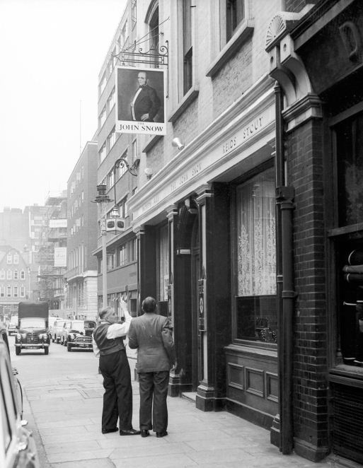 The John Snow pub in Broadwick Street, Soho in 1955. John Snow was the physician that realised almost exactly 100 years before in 1854 that Cholera spread through the water supply and not the air. He tracked an outbreak from a water pump situated right here.