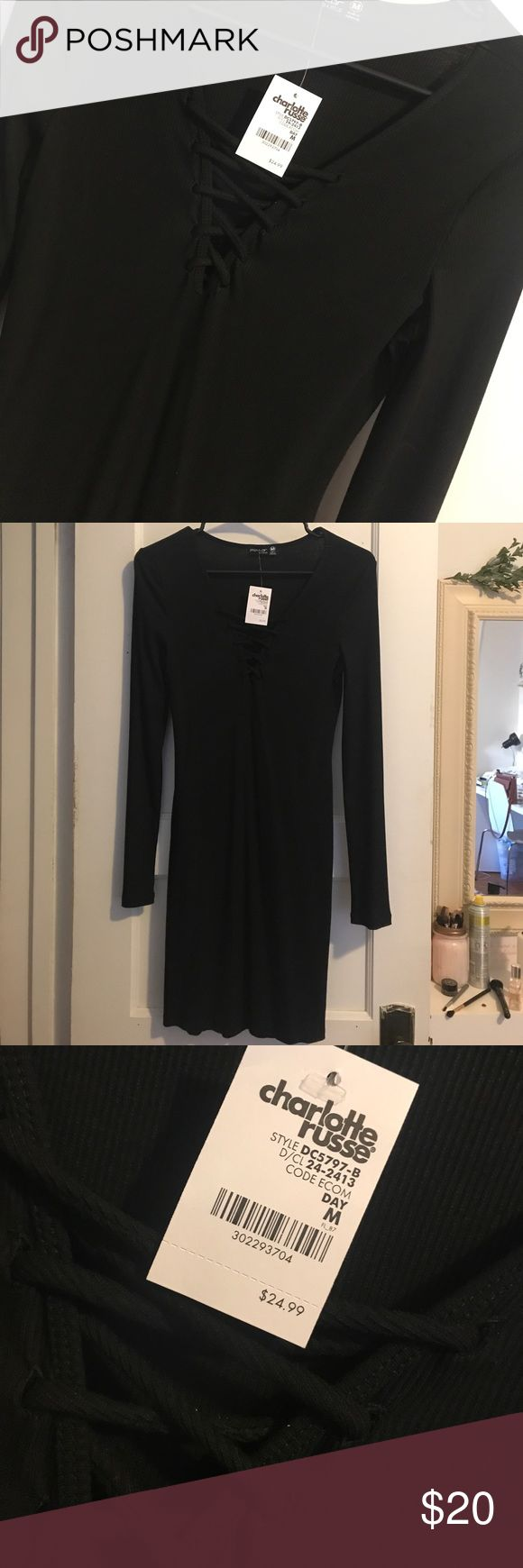 Charlotte Rousse black long sleeved body-con dress Black long sleeved body-con dress with crisscrossing strings in the front. Never worn, with tags and in good condition. Dresses Long Sleeve
