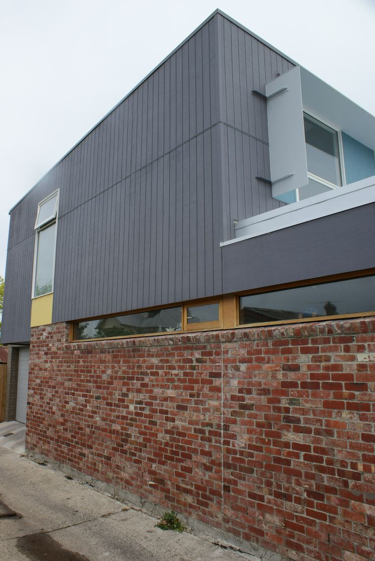 Laneway house by Architected- Recycled Northcote Bricks (from a Richmond church) with plywood upper storey cladding. If detailed correctly the ply cladding can look very sharp.