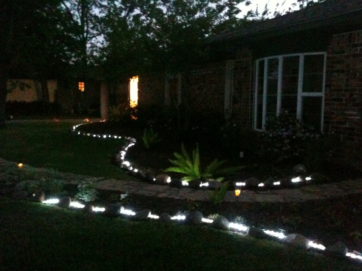 Lighting front flower beds with rope lights Idea from Pinterest