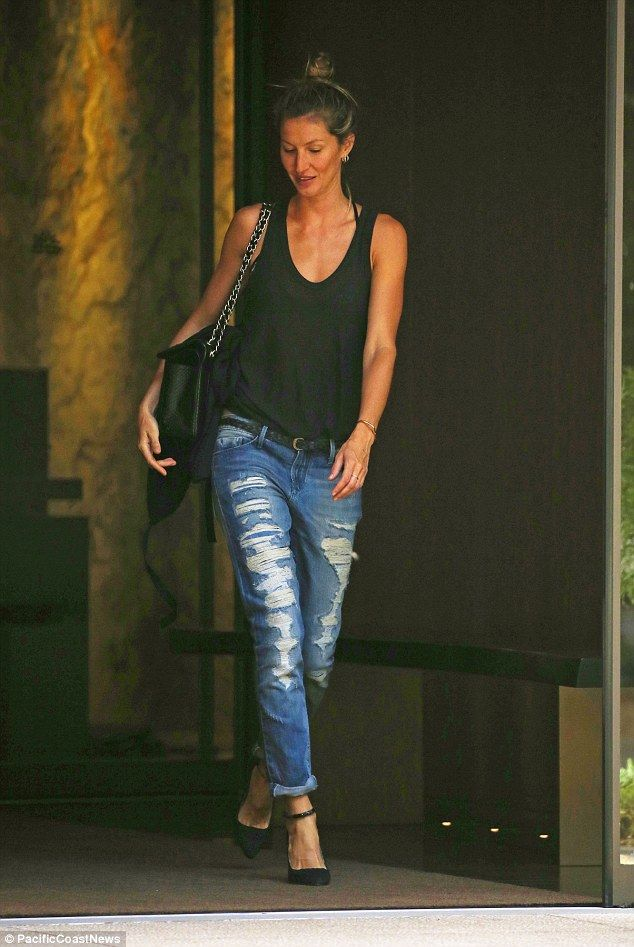 Stylish and strong: Gisele wore a pair of ripped jeans, stiletto heels and a tank top that showed off her sculpted arms