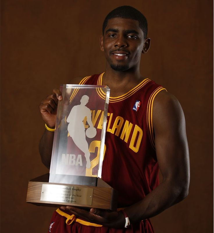 Kyrie Irving #2 of the Cleveland Cavaliers is the recipient of the Eddie Gottlieb Trophy as the 2011-12 Kia NBA Rookie of the Year as he poses for a portrait on May 15, 2012 at Cleveland Clinic Courts in Independence, Ohio. Copyright 2012 NBAE (Photo by Gregory Shamus/NBAE via Getty Images)