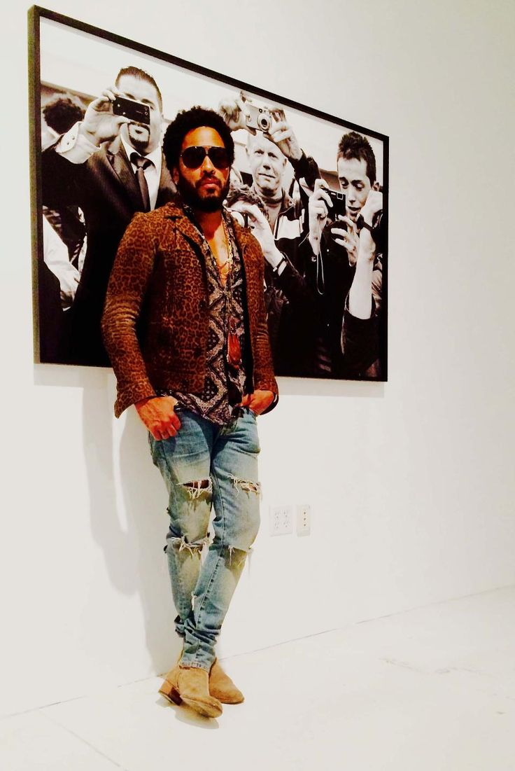 """Lenny Kravitz poses before one of his """"Flash"""" exhibit photos during December's Art Basel in Miami."""
