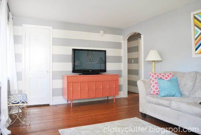 Colorful and Fresh living room makeover on a budget from Classy Clutter.   Coral may be my new favorite color. May repaint family room buffet this color. Coral, turquoise, grey, mustard yellow!On A Budget, Living Rooms, Stripes Wall, Families Room, Room Makeovers, Mustard Yellow, Diy Projects, Classy Clutter, Accent Wall