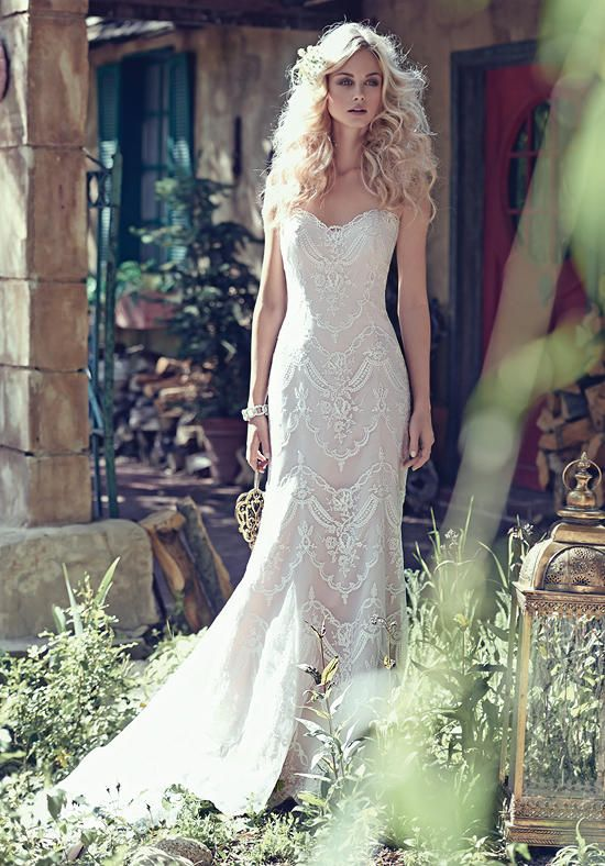 Bohemian sheath wedding dress with lace appliqués | Maggie Sottero | https://www.theknot.com/fashion/kirstie-maggie-sottero-wedding-dress