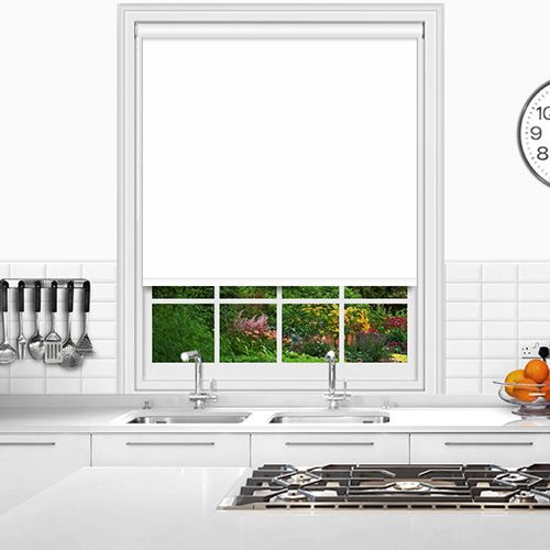 Custom made white PVC roller blind that is flame retardant and waterproof with a white circular bottom bar.