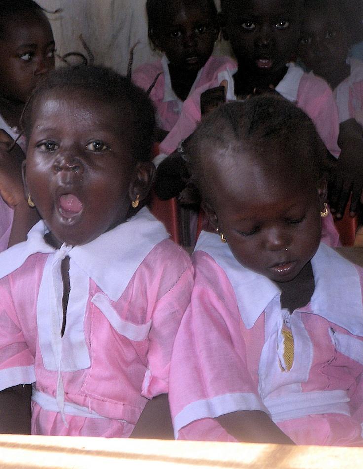 Two sleepy school girls. The Gambia (@David Nilsson Copeland Dreams)