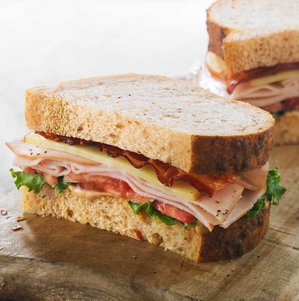 Smoked turkey breast, applewood-smoked bacon, smoked Gouda, lettuce, tomatoes and our signature sauce on our freshly baked Tomato Basil Bread.- Visit PaneraBread.com for more inspiration.