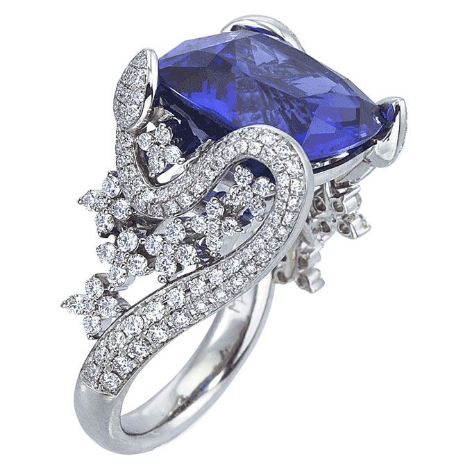 Brides.com: . 18k white gold and diamond Garden Collection ring with cushion-cut tanzanite center stone, Mark Patterson See more white gold engagement rings.