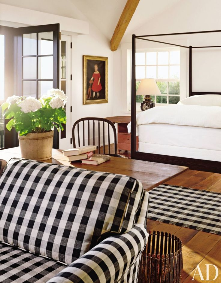 A traditional black-and-white bedroom by Karin Blake in Malibu
