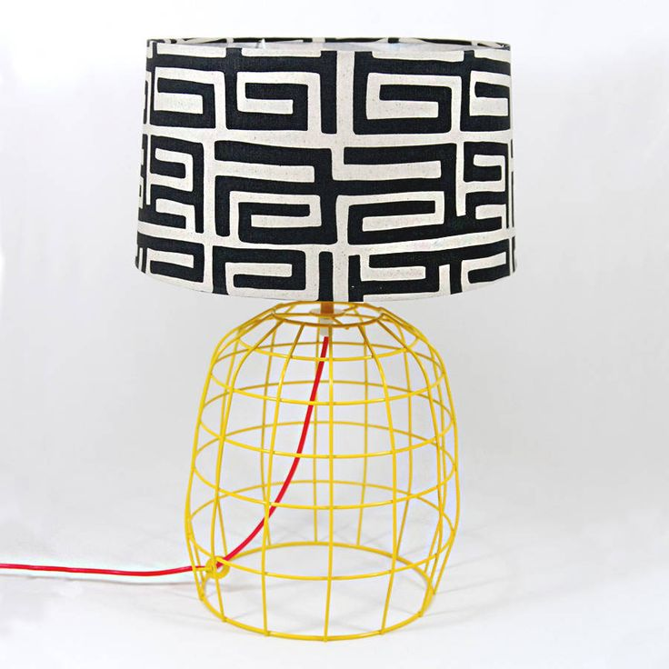 Contemporary lamps for the home.Available in eight unique designs.Bring a touch of style into your home and make a statement with this gorgeous Table Lamps. Each lamp is unique with different coloured bases, traditional african fabrics on the lampshades and brightly coloured cords. Would make the perfect accessory for any room in the house and a great gift for newly weds or new home owners. Designed by the talented Indigi team and produced by their local craftsmen in South Africa.Geometric…