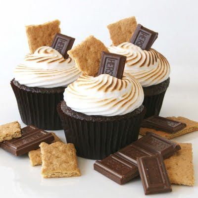 "S'mores cupcakes....♥♥...  ""A delicious chocolate cupcake is paired with light and fluffy mashmallowy frosting and topped with the traditional elements of s'mores… graham crackers and chocolate."""