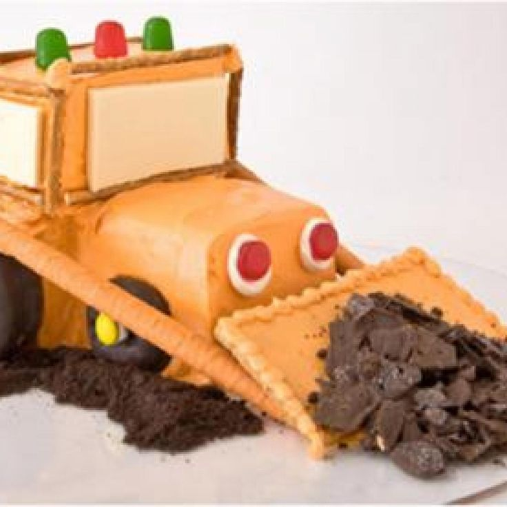 Sweet! How to make a bulldozer birthday cake with chocolate-covered doughnuts. Easy, step-by-step recipe, diagrams and pictures - parenting.com