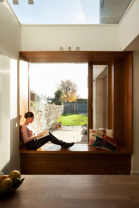 Sunny window seat in a restored 19th-century Irish terrace house.